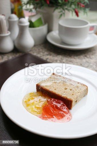 Dessert baked or fruit bread on white dish in a restaurant.
