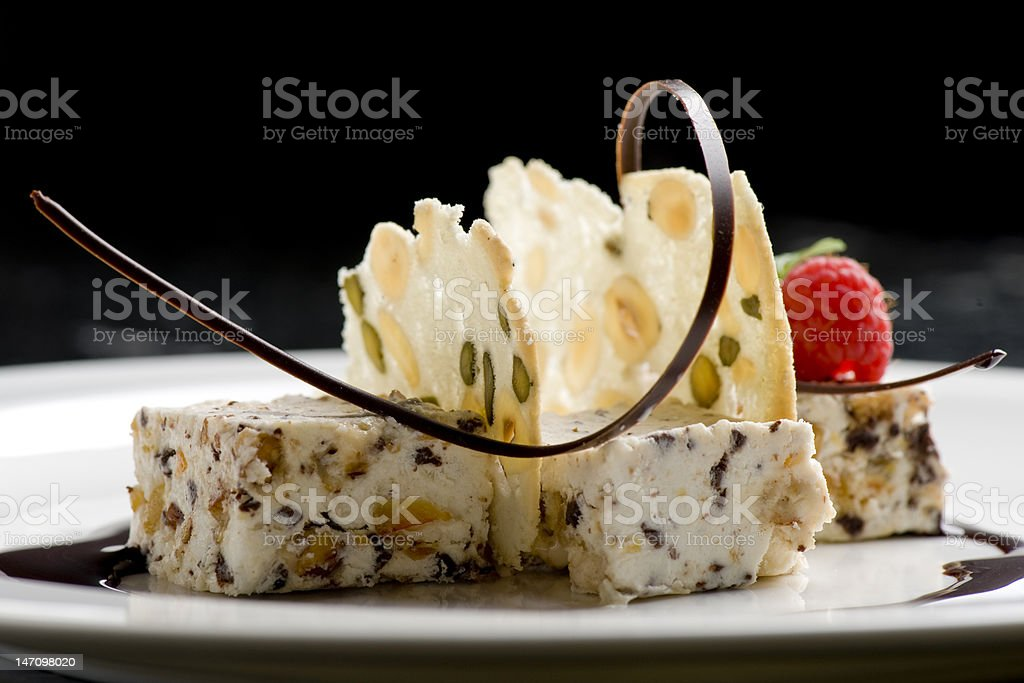 dessert - cheese, nuts, raspberry and a chocolate strip royalty-free stock photo