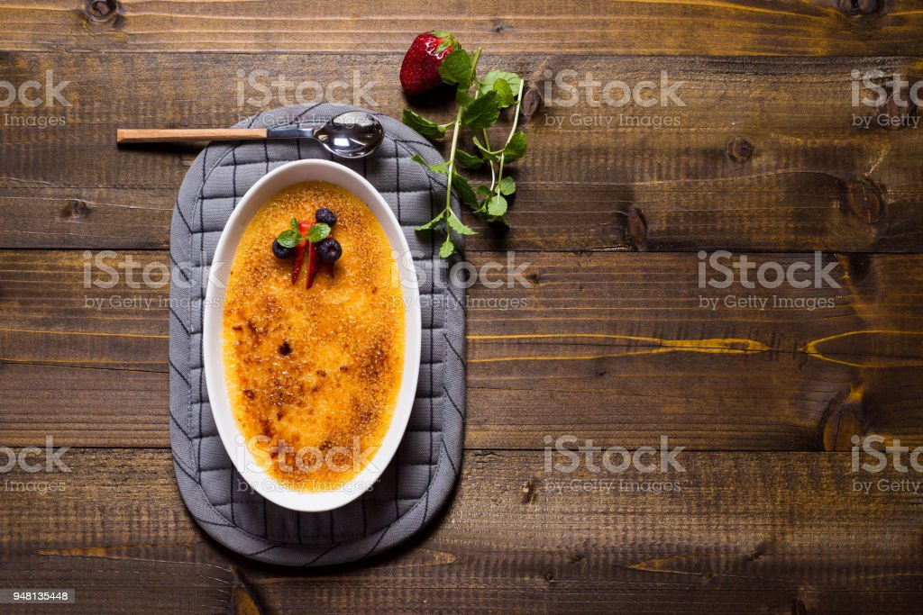Dessert Creme Brulee with Strawberry, Blueberry and Fresh Mint Leaves stock photo