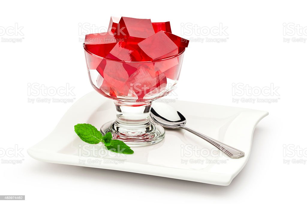 Dessert cup filled with red gelatin. stock photo