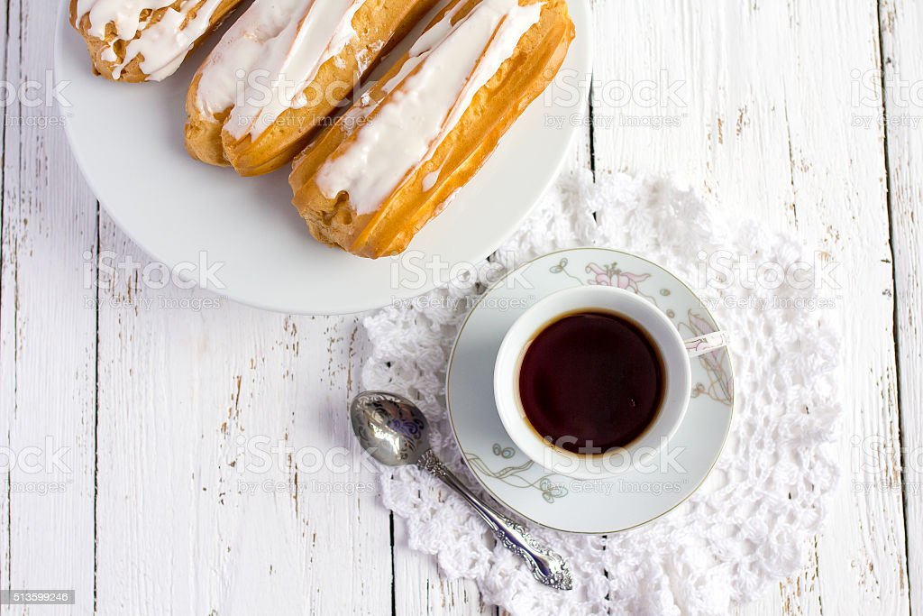 Dessert Eclair with whipped cream stock photo