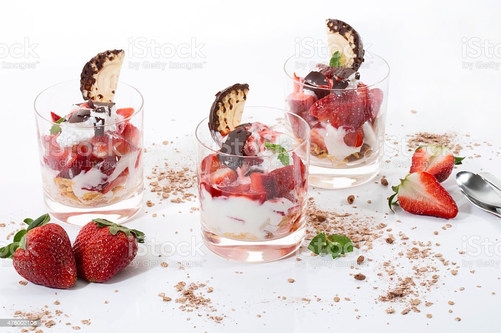 Dessert in glasses, yogurt, curd, strawberries, chocolate marshmallows and mint stock photo