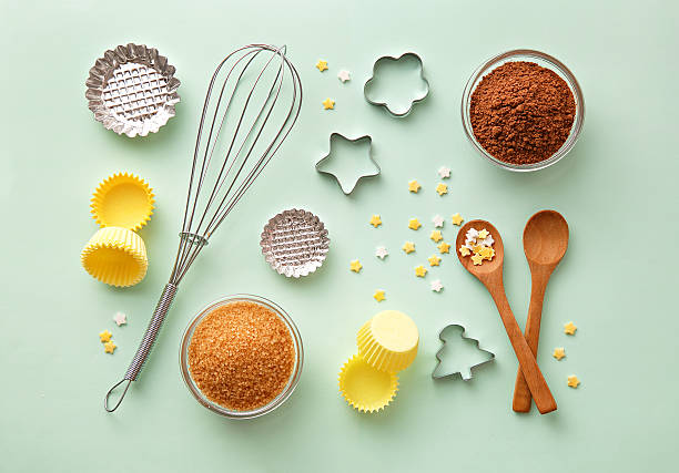 Dessert ingredients and utensils on green pastel background. Top view stock photo