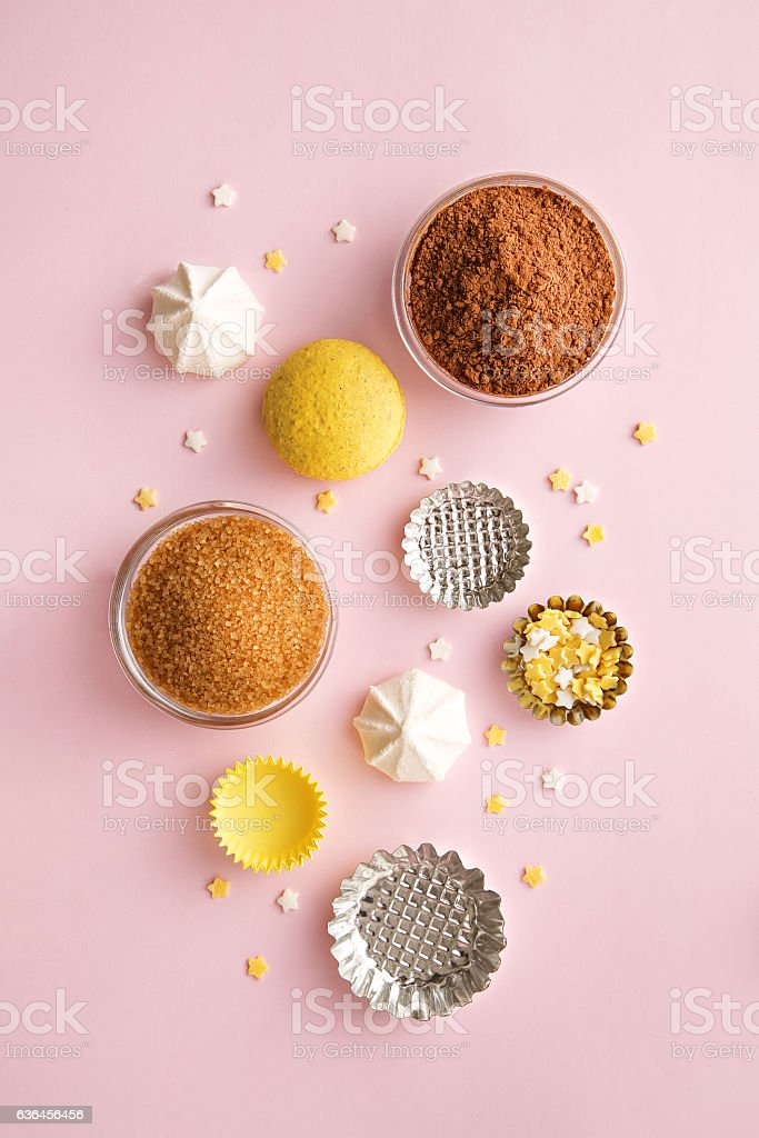 Dessert ingredients and utensils on pink pastel background. Top view stock photo