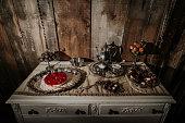 Winter themed wedding desserts including old tea set.