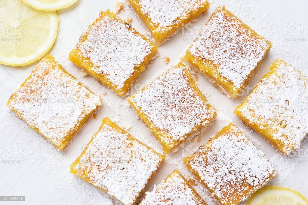 Dessert lemon bars over baking paper stock photo