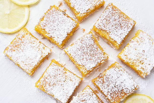 Dessert lemon bars over baking paper stock photo