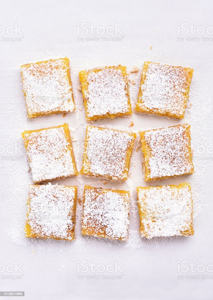 Dessert lemon bars over baking paper, top view stock photo