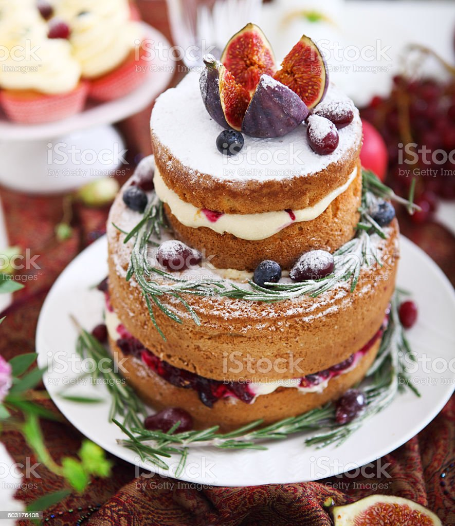 Dessert table for a wedding. Cake, cupcakes, sweetness, fruits stock photo
