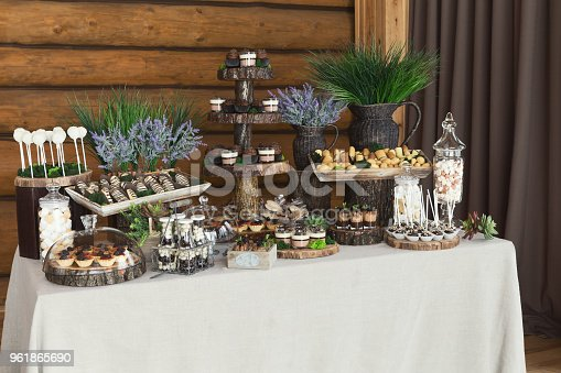 istock Dessert table for any holiday at wooden background 961865690