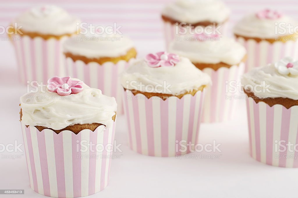 Dessert table of pink and white retro style cupcakes stock photo