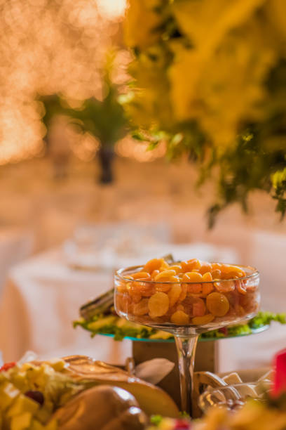 Dessert table with refractory of dried apricots Dessert table with refractory of dried apricots reveillon stock pictures, royalty-free photos & images