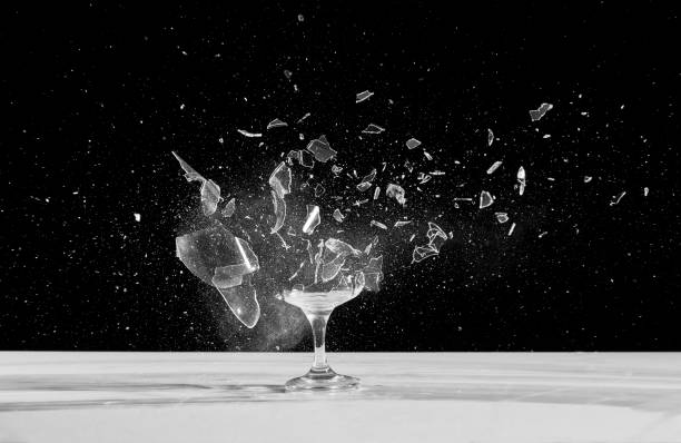 dessert wine glass crashing The glass is placed in a dark room slow motion stock pictures, royalty-free photos & images
