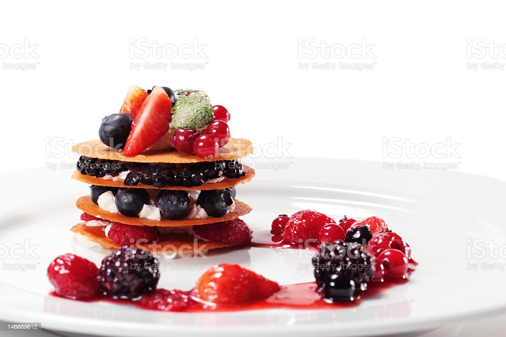 A dessert with berries on a white plate stock photo