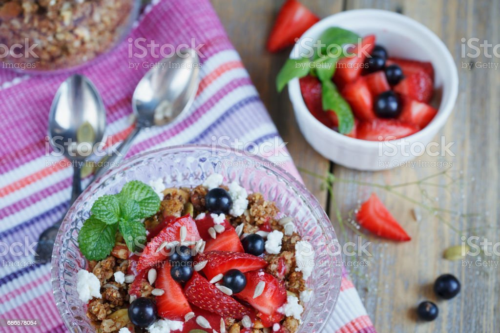 Dessert with fresh berries, cottage  cheese, granola and berries jam photo libre de droits