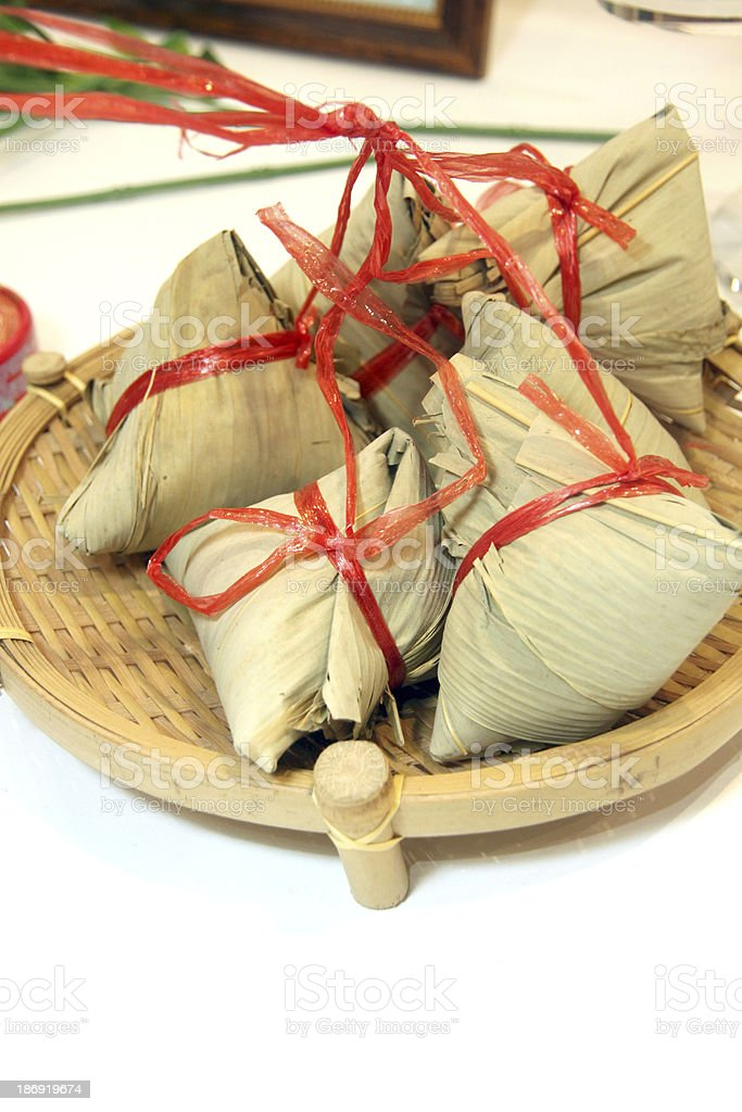 Dessert wrapped in banana leaves. royalty-free stock photo