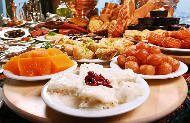Desserts (Click for more) Dessert Backgrounds (Traditional Turkish Desserts- Baklava, Tulumba, Güllaç, Sütlaç, Lokma, Kabak Tatlısı) persian culture stock pictures, royalty-free photos & images