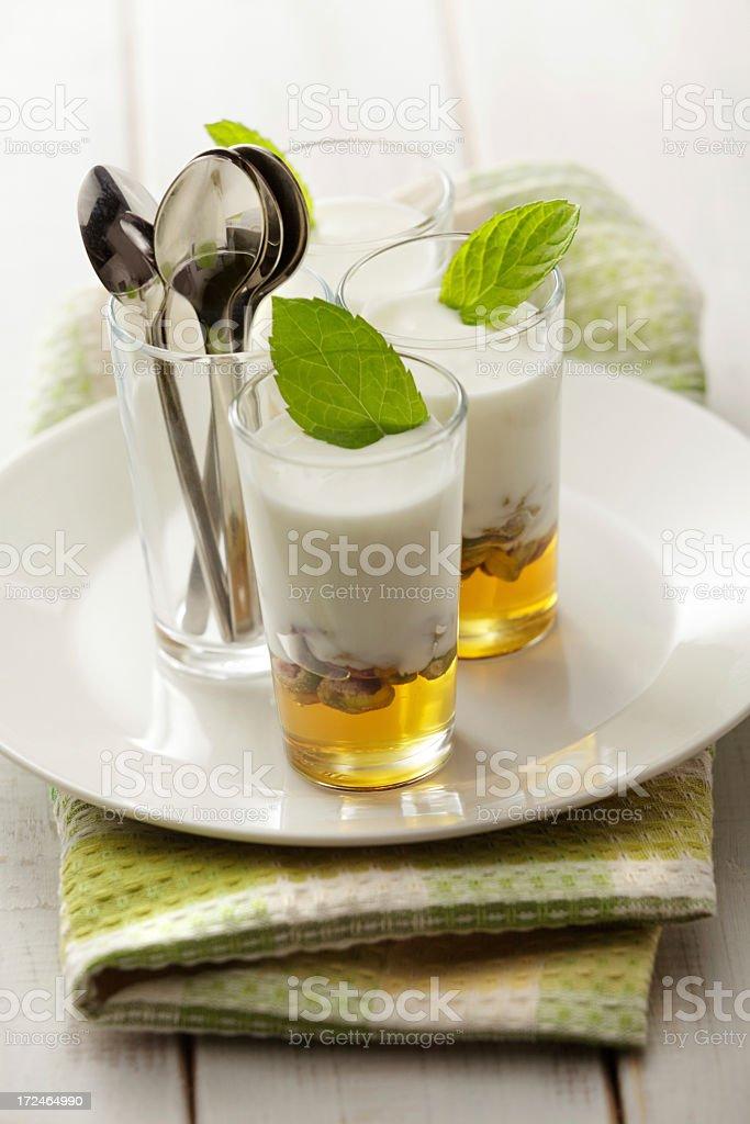 Desserts: Yogurt with Pistachio, Honey and Mint Still Life royalty-free stock photo