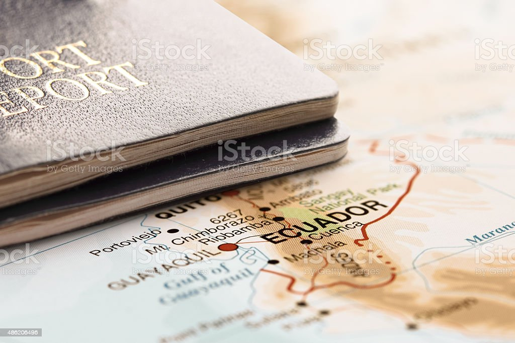 Destination Ecuador. Two passports on the map. Travel concept. stock photo