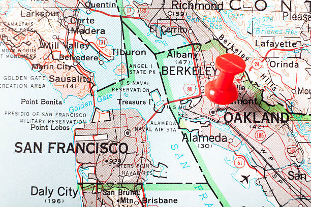 Destination Oakland California Red pushpin marking on a map city of Oakland in San Francisco Bay.  san francisco bay stock pictures, royalty-free photos & images