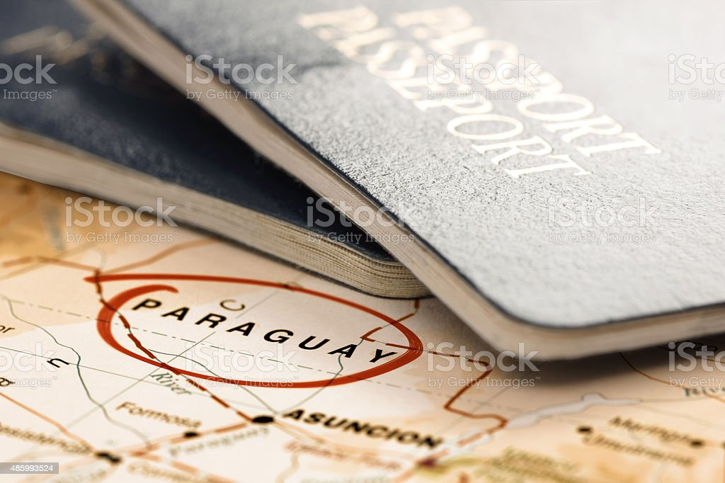 Destination Paraguay. Passports on the map. Travel concept. stock photo