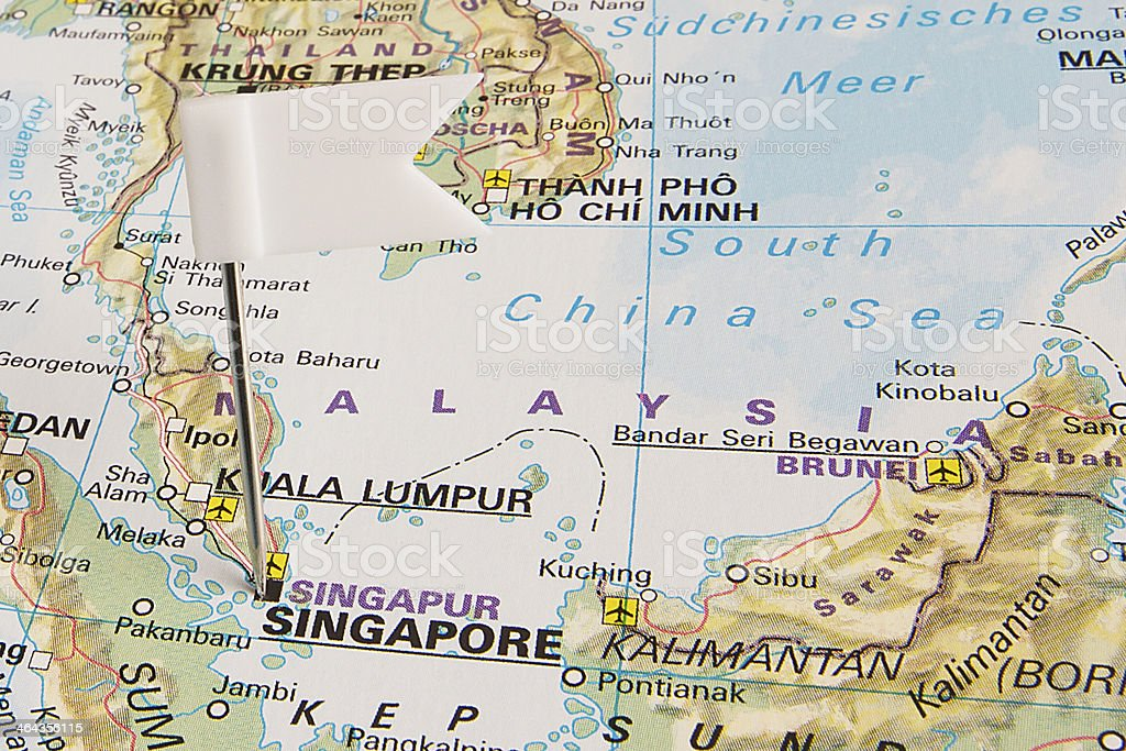 A white pushpin pinpointing the Republic of Singapore on a map.