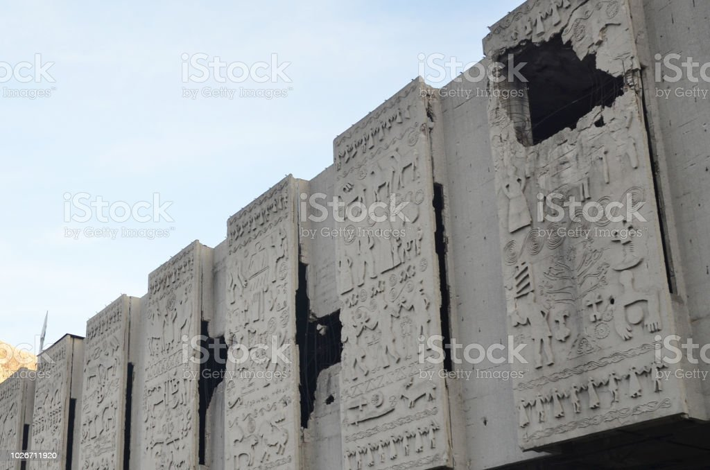 Destroyed and damaged building during war in Bosnia. The mark of bullets still can be seen around Mostar. stock photo