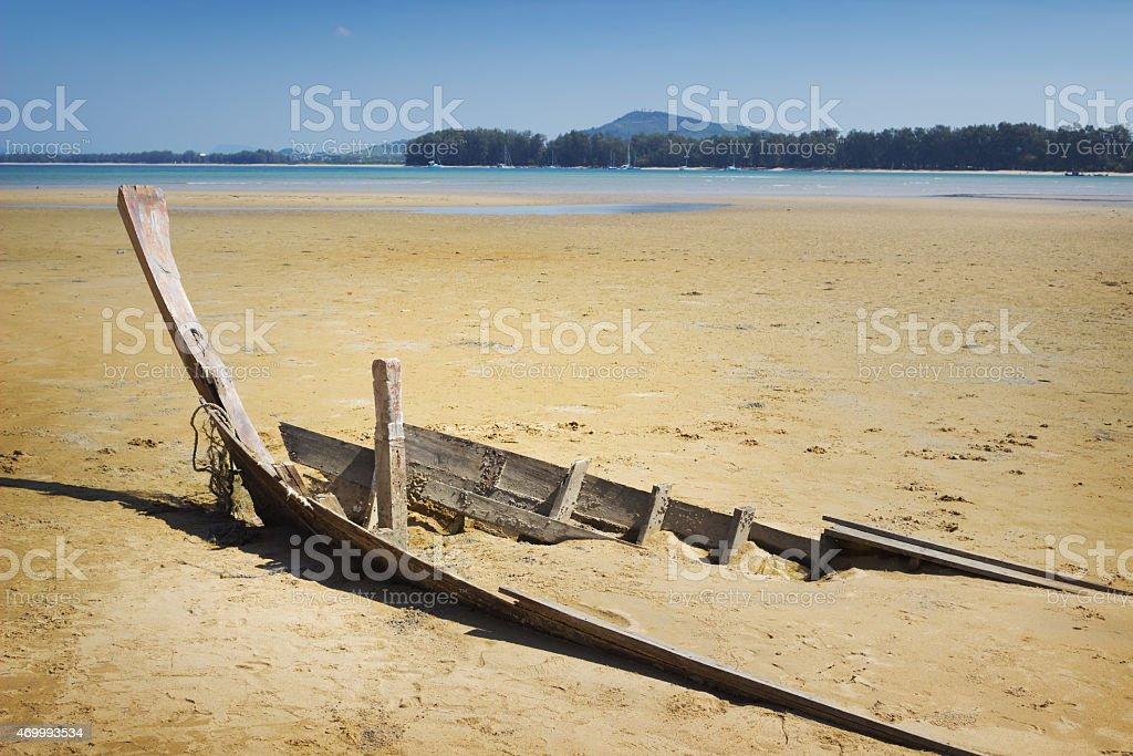 Destroyed boat in area of sea tide Skeleton of destroyed boat in area of sea tide 2015 Stock Photo title=Destroyed boat in area of sea tide Skeleton of destroyed boat in area of sea tide 2015 Stock Photo