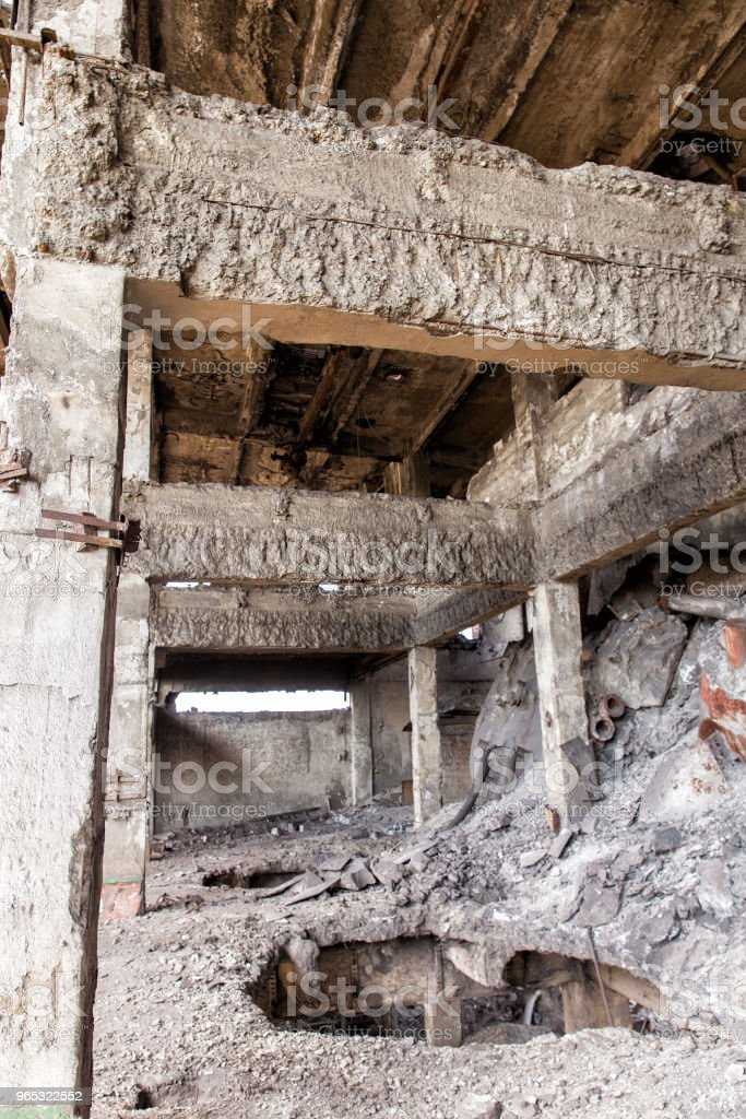 Destroyed building after artillery shelling royalty-free stock photo