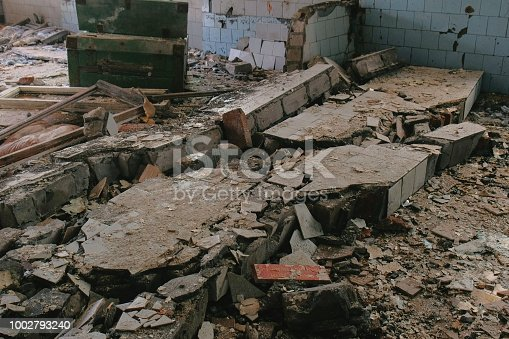 istock Destroyed building after the disaster earthquake, flood, fire. 1002793240