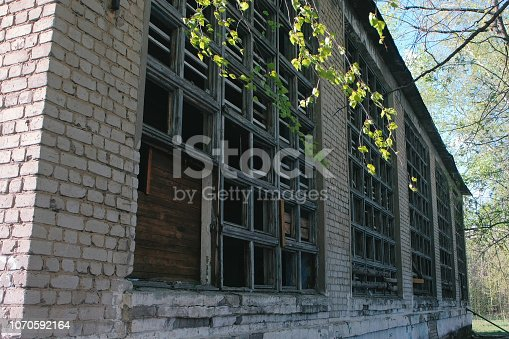 istock Destroyed building after the disaster earthquake, flood, fire with broken windows. 1070592164