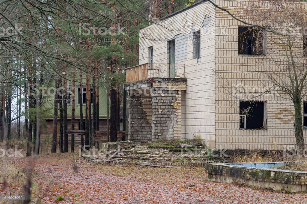 Destroyed building in the woods, Post Apocalyptic. stock photo