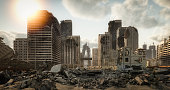 Digitally generated post apocalyptic scene depicting a desolate urban landscape with buildings in ruins and lots of rubble through the city streets.\n\nThe scene was rendered with photorealistic shaders and lighting in Autodesk® 3ds Max 2020 with V-Ray Next with some post-production added.