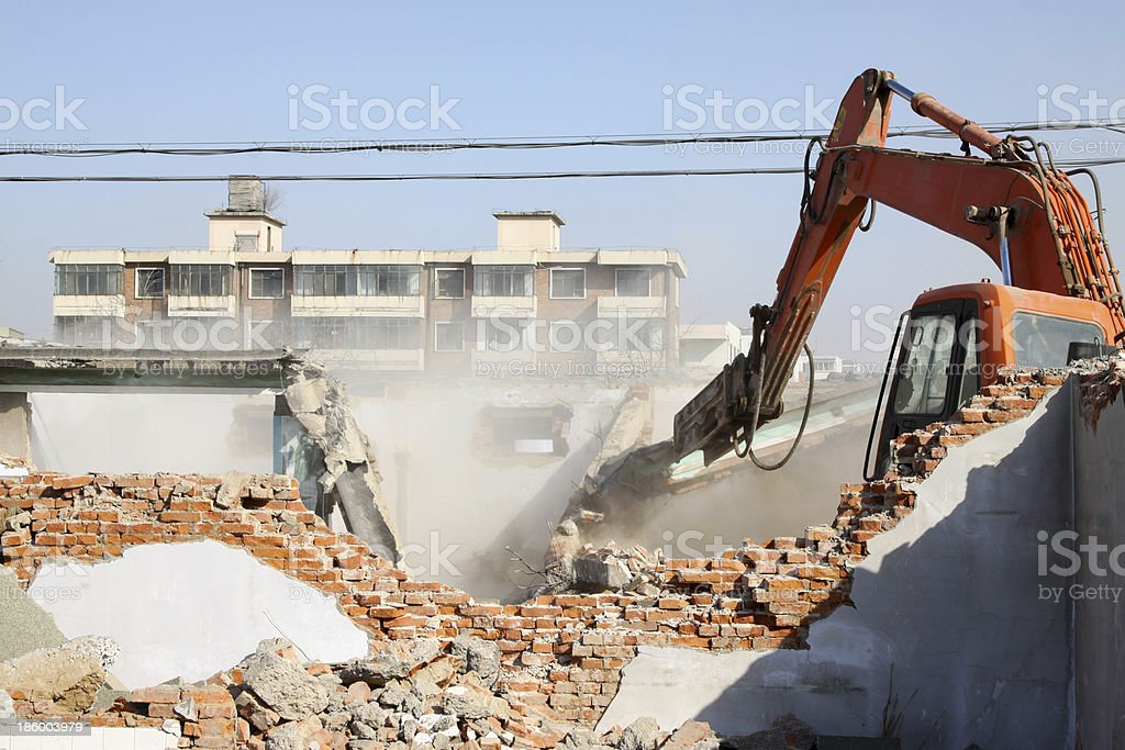 destroyed house and machinery stock photo