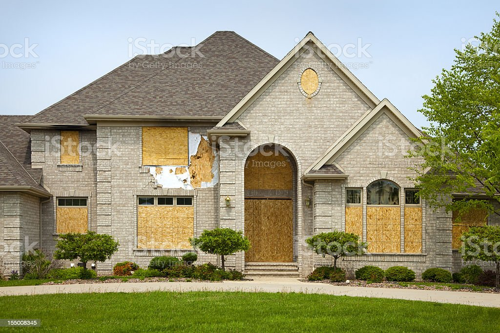 Destroyed Mansion House With Boarded Windows stock photo