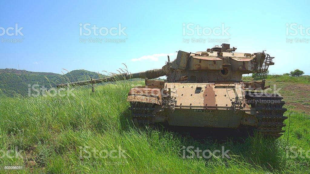 Destroyed rusty tank on battlefield near the border stock photo