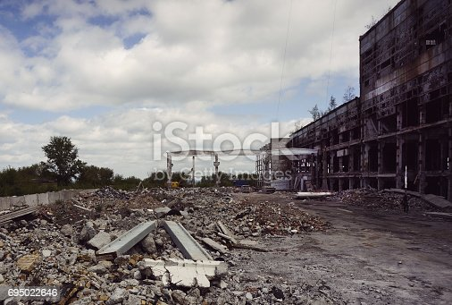 istock Destroyed the factory building and the road 695022646