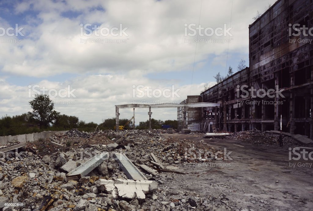 Destroyed the factory building and the road stock photo