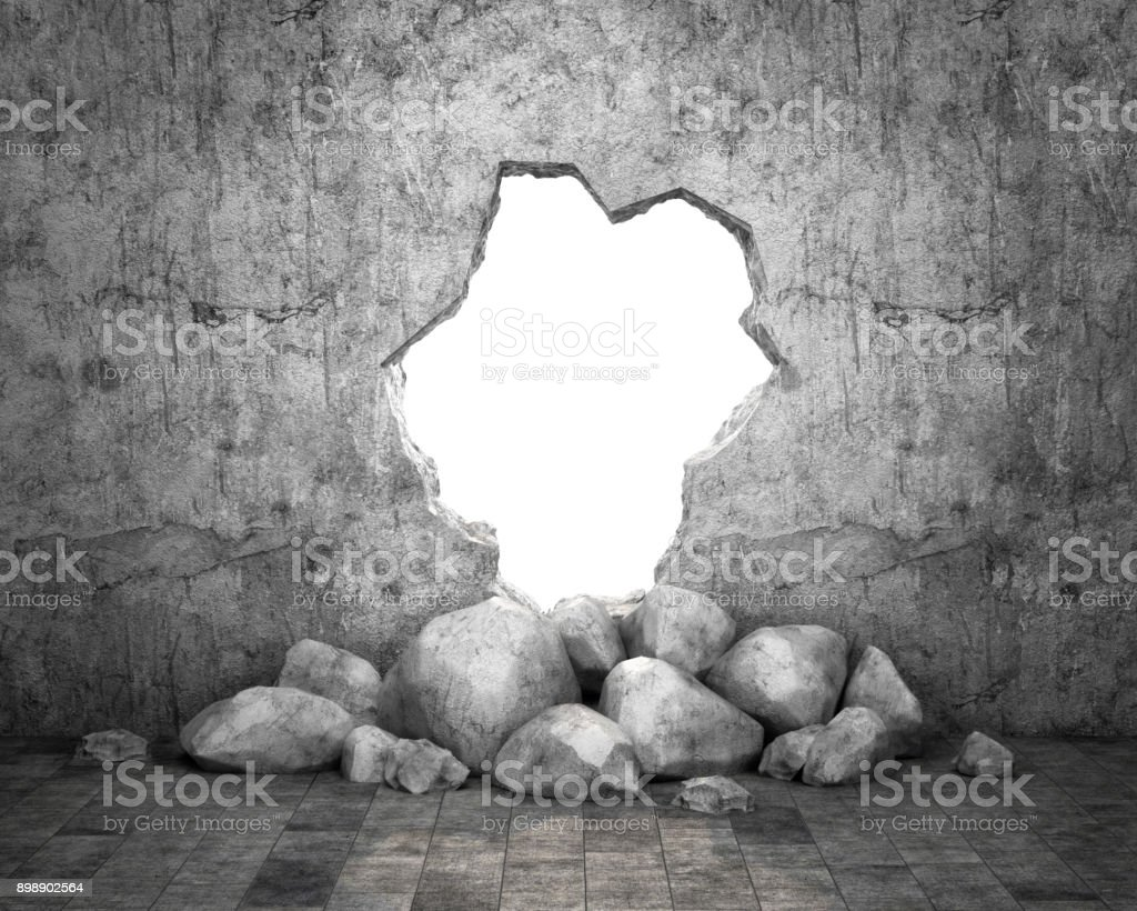 Destroyed wall of concrete structure. Concept of escape to freedom stock photo