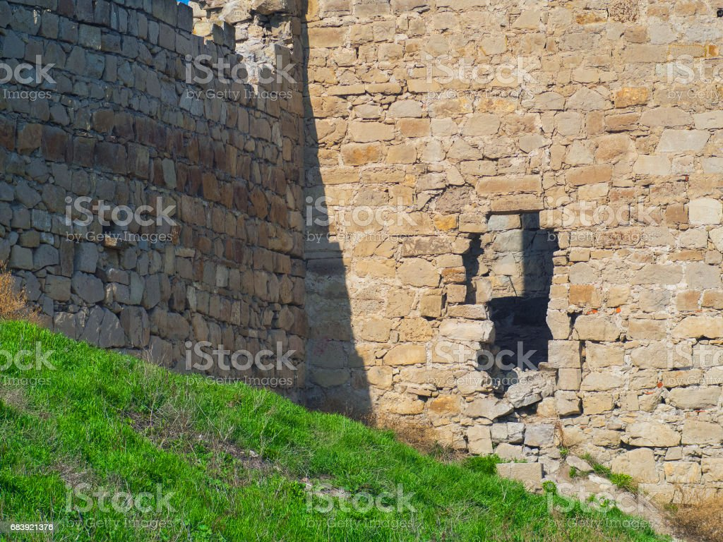 Destroyed wall of the old Genoese fortress stock photo