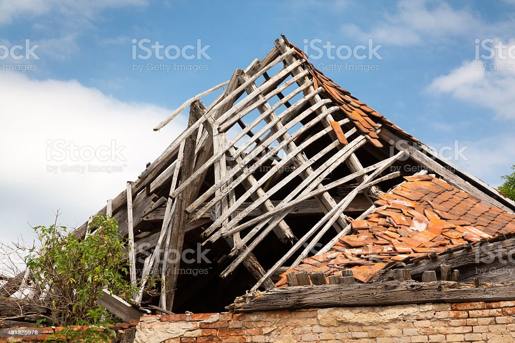 Destroyed wooden roof stock photo