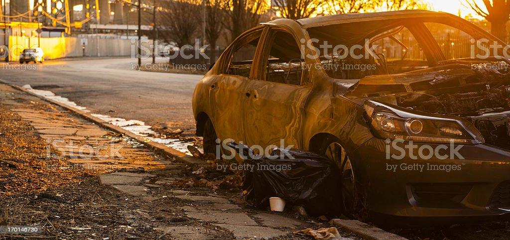 Destroyed,burned and rusty, car under the Kosciuszko bridge royalty-free stock photo