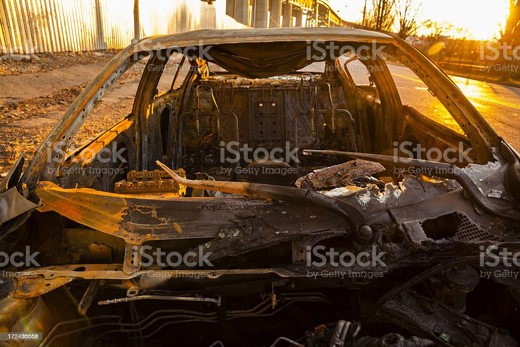 Destroyed,burned and rusty, car under the Kosciuszko bridge royalty-free stock photo