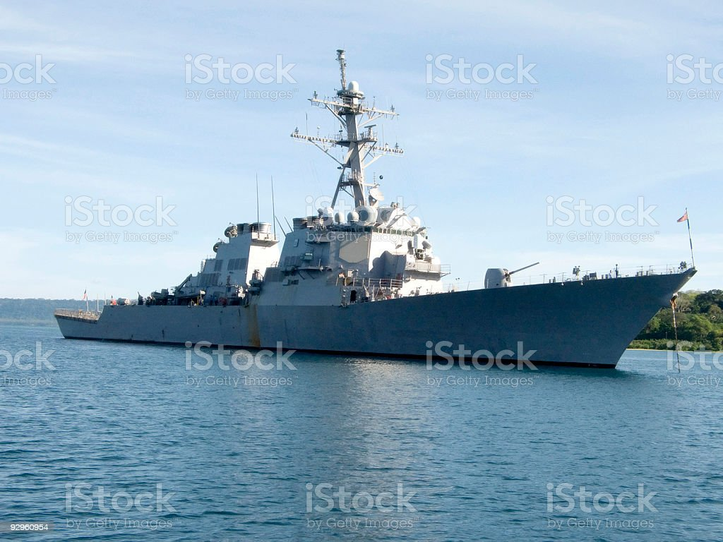 Destroyer anchored in harbor on a cloudy day stock photo