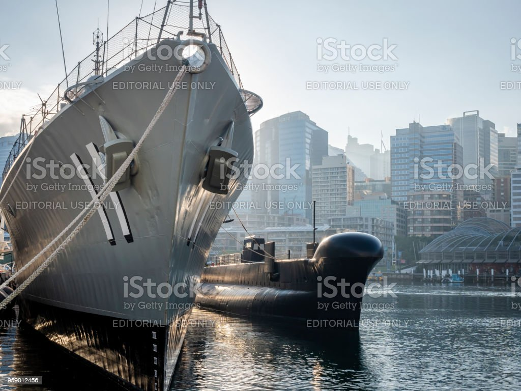 Destroyer HMAS Vampire moored alongside submarine HMAS Onslow stock photo