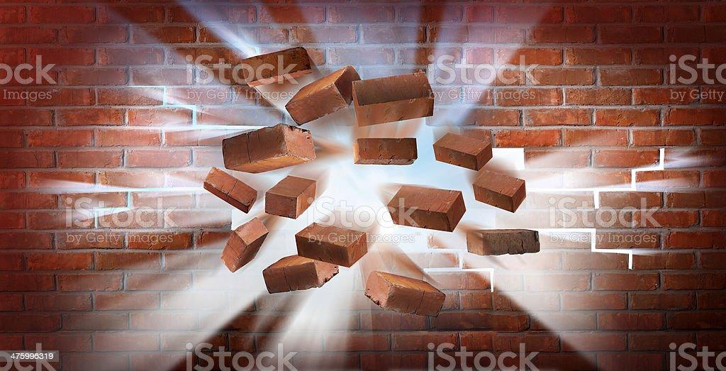 Destroying brick wall stock photo
