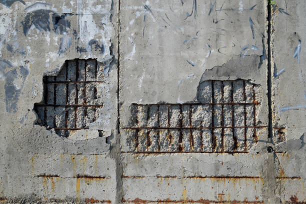 Destroying wall of reinforced concrete. falling off plaster Destroying wall of reinforced concrete. falling off plaster. rod stock pictures, royalty-free photos & images
