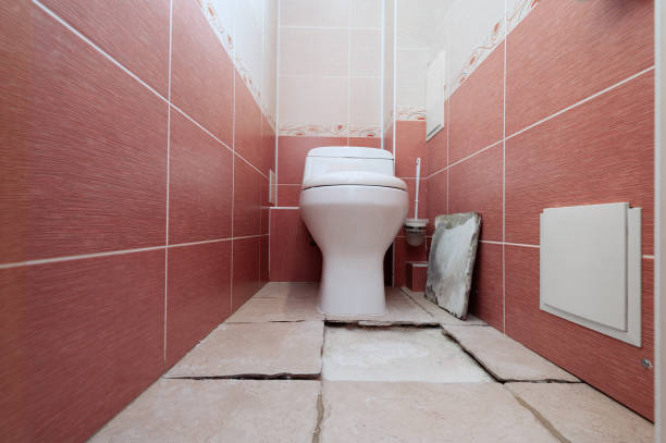 Cтоковое фото Destruction of a ceramic covering of a floor at violation of technology of repair in a toilet