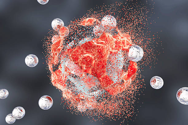 Destruction of a tumor cell by nanoparticles Destruction of a tumor cell by nanoparticles. 3D illustration. Can be used also to illustrate effect of drugs, medicines, microbes nanoparticle stock pictures, royalty-free photos & images