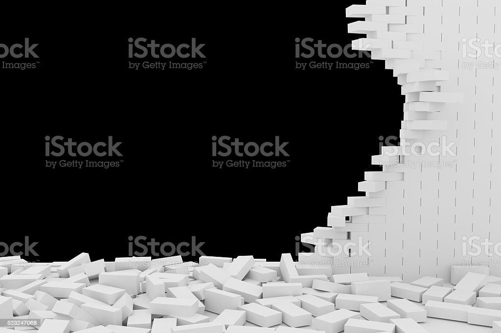 Destruction of a white brick wall on black background stock photo